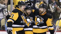 Bryan Rust, centre, bagged a brace to send Pittsburgh into the Stanley Cup Final (AP)