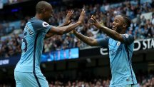 Raheem Sterling, right, celebrates with team-mate Fernandinho after scoring Manchester City's third goal