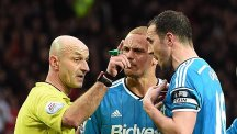Referee Roger East, left, insists it was not a case of mistaken identity when he sent off Wes Brown, centre, rather than John O'Shea, right
