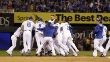The Kansas City Royals celebrate their thrilling victory over the Oakland Athletics (AP)