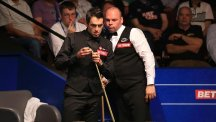 Ronnie O'Sullivan, left, trailed Stuart Bingham at the Crucible