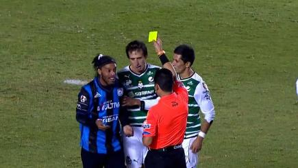 Ronaldinho booked for embarrassing dive