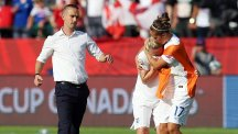 Mark Sampson, left, had only praise for Laura Bassett, centre, after her late own goal condemned England to defeat