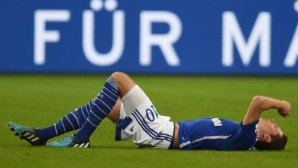 Schalke winger Julian Draxler picks up an early injury against Augsburg