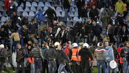 Europa League game suspended as fans clash