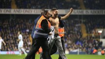 Spurs win marred by pitch invasions