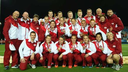 The England Women hockey squad celebrate winning the silver medal at the 2014 Commonwealth Games