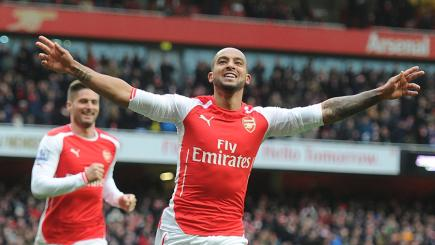 Theo Walcott celebrates his goal against Aston Villa