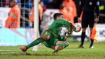 West Brom goalkeeper Ben Foster, pictured, saves the decisive penalty from Peterborough's Lee Angol to win the shoot-out 4-3