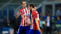 Diego Godin, left, scored the game's only goal as Atletico Madrid beat Tottenham 1-0 in Melbourne