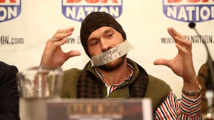 Tyson Fury tapes mouth up at Chisora fight press conference as protest at fine.