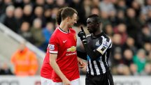 Papiss Cisse, right, and Jonny Evans were both charged with spitting by the Football Association