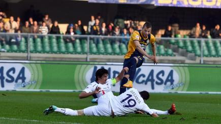Verona forward Nico Lopez is denied by the Fiorentina defence