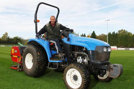 Volunteer Keith Williams helps gets Shortwood's pitch in shape. (Picture: Carl Hewlett/TWM)