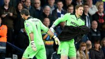 Crystal Palace's Julian Speroni (left) is replaced by Wayne Hennessey after being hurt by Craig Dawson's challenge