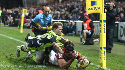 Sione Kalamafoni of Gloucester dives over for a try against Sale Sharks in the Aviva Premiership.