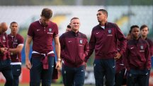 Wayne Rooney, centre, on England's pre-match visit to the San Marino Stadium