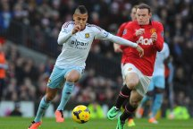 West Ham midfielder Ravel Morrison takes on his former team-mate Wayne Rooney
