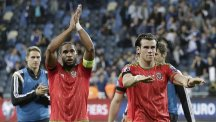 Wales captain Ashley Williams, left, says summer holidays have been put on hold ahead of the showdown with Belgium in June