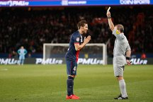 Yohan Cabaye (L) gets a yellow card from referee Lionel Jaffredo