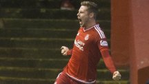 Aberdeen's Simon Church celebrates his goal against Celtic