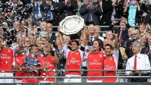 Arsenal skipper Mikel Arteta lifts the Community Shield after the Gunners' 3-0 win over Man City