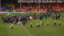 Blackpool fans caused their clash with Huddersfield to be abandoned by staging a sit-in protest